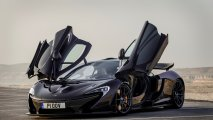 McLaren P1 front side view open gullwing doors